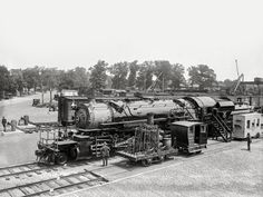 "Big Boumi: 1923 / ""Past and present in locomotives. Eckington Yards, June 4, 1923."" A closeup of the locomotive seen here yesterday in the Baltimore & Ohio rail yard during the Masonic convention in Washington, D.C. The big engine wears the livery of ""Boumi Temple,"" a Baltimore Shrine lodge. 5x7 glass negative."