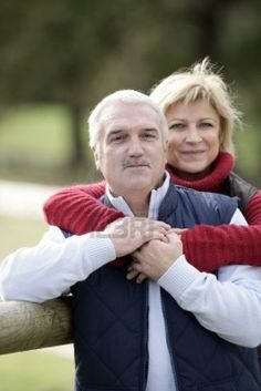 portrait of happy middle-aged couple posing in park Stock Photo - 11755385