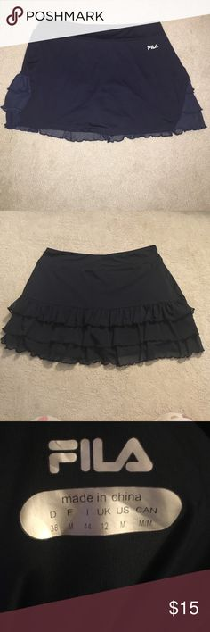FILA tennis skirt NWOT never worn! Size medium NWOT Fila skirt navy size med with ruffle behind and built in shorts Fila Skirts