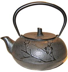 Tetsubin Cast Iron Tea Pot with Cherry Blossoms adorning the surface.