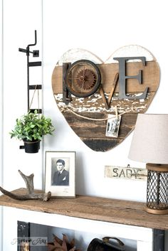 Hang pictures from twine with a junk styled LOVE sign: 3 ways to use a reclaimed wood junk salvaged junk heart! Perfect for Valentine's Day, or all season. | funkyjunkinteriors.net