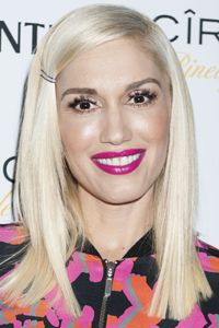 Poker-straigth hair is a stylish statement, and Gwen Stefani nails it with her sleek locks and extreme side parting. Accessorise with hairgrips to stop strands falling across your face.