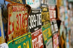 vintage license plates - wrap these around wood planters and you'll have a very unique window or table planter!