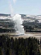 Old Faithful is a cone geyser located in Wyoming, in Yellowstone National Park in the United States. Old Faithful was named in 1870 during the Washburn-Langford-Doane Expedition and was the first geyser in the park to receive a name. It is also called the most predictable geographical feature on Earth erupting almost every 91 minutes.