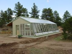 Sustainable, all-year-round greenhouse heated with water reservoirs.  Cheap and great! Source: http://pennandcordsgarden.weebly.com