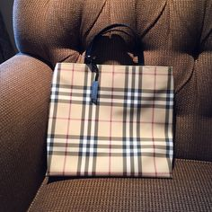 Burberry Nova Check 2 handle Tote Burberry classic Nova Check Handle Tote. Has an inside medium zipper pocket. Pre owned and pre loved but not very worn and has plenty of life left!! Burberry Bags Totes