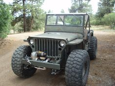 Modified Willys Jeep. Love those BFGs MT KM2's!!