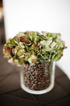 coffee bean centerpiece idea (could also use something besides coffee beans to fill vase - nuts, pinecones, chocolate, etc.)