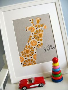Trace an animal shape onto cute paper or fabric, cut, paste and throw into an inexpensive frame for a simple way to dress up your nursery (or dorm!) walls.