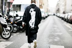 As Paris Fashion Week slowly comes to an end,our roaming lens descends upon Y-3's seasonal showcaseto capture the attendees' uniqueoutfits.