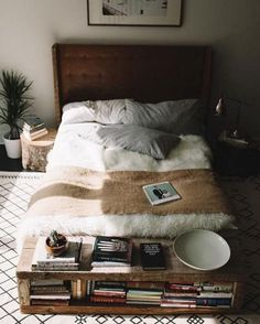 Bedroom decor and design ideas: Don't forget to address the foot of your bed. Fill a rustic bench with a selection of your most treasured books for endless evenings of Hygge.