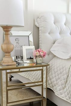 Bedroom decor featuring mirrored nightstand and accessories, white tufted headboard, and wood lamp: Traditional bedroom design and furniture inspiration New Interior Design, Home Interior, Home Design, Design Ideas, Mirrored Nightstand, Mirrored Furniture, Unique Nightstands, Mirrored Table, Nightstand Ideas