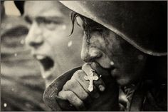 Russian soldier kisses the cross before attack. II World War, Kursk, 1943