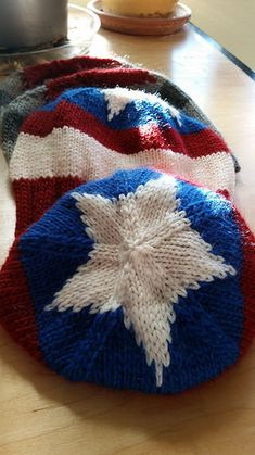 Oh Captain, My Captain:  a Captain America/Winter Soldier-themed hat designed especially for Chris Evans, and all Captain America-lovers out there.