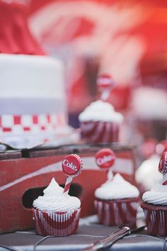 cupcakes with coke bottle caps as toppers at Callie and Spencer's Coca-Cola Themed Wedding at Georiga Rustic Wedding Venue - Fritz Farm. Jaime Warren Photography