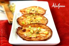 Bengali Malpua is a fried pancake dipped in Chashni, served with rabdi. Indian Desserts, Baked Potato, Fries, Ethnic Recipes, Food, Essen, Meals, Baked Potatoes, Yemek
