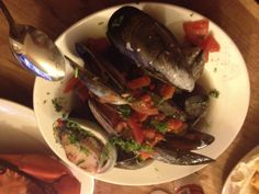 Mmm #mussels cooked in white wine with lots of fresh #chilli, parsley and #garlic.