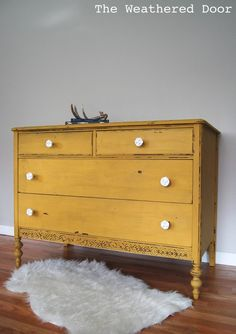 A chippy, mustard yellow dresser – The Weathered Door