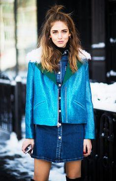 Chiara Ferragni wears a denim button-down dress, Rodarte motorcycle jacket, and knee-high boots