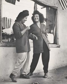 "photograph by Max Yavno of ""las pachucas"" — Chicana zoot suiters, in pant suits. Photo titles ""Two Women"" 1946 via http://ofanotherfashion.tumblr.com/"