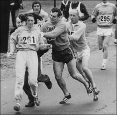 "In 1967, Kathrine Switzer was the first woman to run the Boston marathon. After realizing that a woman was running, race organizer Jock Semple went after Switzer shouting, ""Get the hell out of my race and give me those numbers."" However, Switzer's boyfriend and other male runners provided a protective shield during the entire marathon.The photographs taken of the incident made world headlines, and Kathrine later won the 1974 NYC marathon (women's division) with a time of 3:07:29."