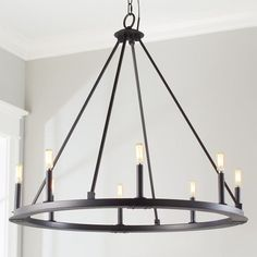 Minimalist Iron Ring Chandelier - 8 Light,This substantial chandelier offers an unadorned minimalist silhouette consisting of a large iron ring with four iron rods extending upward in a pyrami. Circular Chandelier, Ring Chandelier, Black Chandelier, Chandelier Shades, Lantern Chandelier, Chandelier Lighting, Chandelier Ideas, Entryway Chandelier, Farmhouse Chandelier