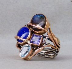 SANDRA DINI ABOUT:  Handicraft is the principal element that gives charm and appeal to these refined and very personal creations in silver; white, red and yellow gold; precious and semiprecious stones; pearls and coral. Indeed, the artist Sandra Dini, through her experience and sensitivity, is able to transform the intrinsic qualities of stone and metal into an original style, creating elegant objects which are finely balanced in shape and color.