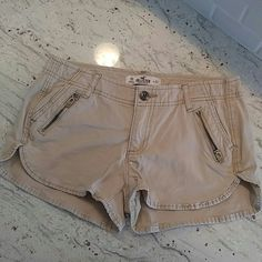 Hollister shorts sz 00 w23 tan GREAT CONDITION Like new Zipper detail in front Two front pockets Two back pockets NO STAINS OR HOLES  If you have any questions or would like more pics please like and leave a comment   Make me an offer! All offers are considered considered. I understand that you pay for shipping and I try to factor that in the pricing. Hollister Shorts