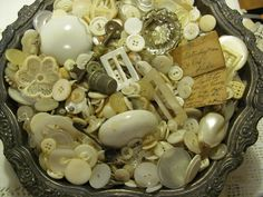 I like the idea of Mother of Pearl buttons in an open container so you can sift through them.