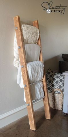 What a great idea! Never liked blankets in closets and all over the floors and couches anyways! Wood and Metal Pipe Blanket Ladder #site:bestartsandcrafts.com