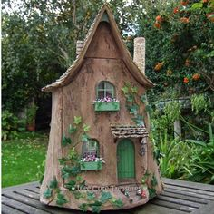 It is a fairy tree stump house in 1:12 scale but fits into an a life size ivy covered ' tree trunk'. Description from weecutetreasures.blogspot.co.uk. I searched for this on bing.com/images