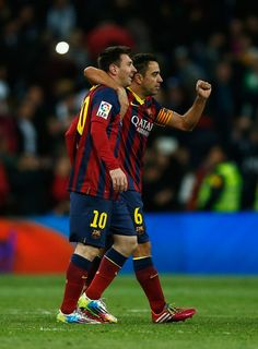 Lionel Messi (L) of Barcelona celebrates victory with Xavi after the La Liga match between Real Madrid CF and FC Barcelona at the Bernabeu on March 23, 2014 in Madrid, Spain.