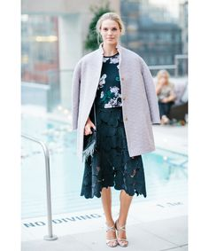 work florals into fall with a dark dress and a jacket.