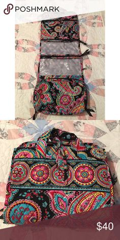 """Vera Bradley Hanging Organizer Parisian Paisley print.                                       Top zippered, quilted compartment plus two taffeta-lined, clear plastic compartments Gusseted, plastic-lined bottom compartment opens wide when unzipped Easy-tie closure and two carry handles Dimensions: 11 """" w x 29 ¼"""" h x 2 ½"""" d with 4 ½"""" handle drop.  Used a handful of times. In great condition. Bags Travel Bags"""
