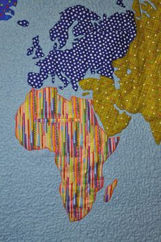 close up, World Map quilt by Tracey Pereira. Each continent is a different fabric.