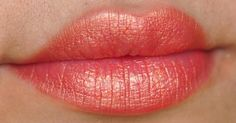 MAC's Sandy B lipstick, a shimmery and gold peach.