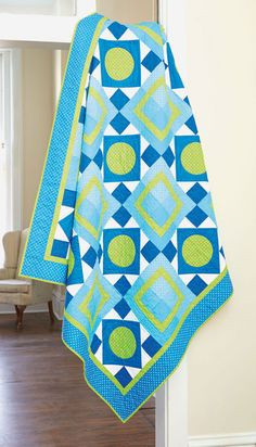With polka dots, circles, and squares, there's a lot to love about this throw size quilt pattern with Circle and Four Patch quilt blocks.
