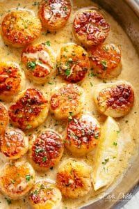 Creamy Garlic Scallops are just as good as restaurant scallops with minimal ingredients and maximum flavour! A silky, creamy garlic sauce with a hint of lemon coats crispy, buttery scallops! With only a handful of ingredients, you're minutes away from having the most incredible scallops on your dinner table!   cafedelites.com