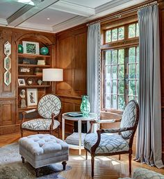 Transom windows provide a sunny reading corner, complete with a pair of French chairs and a cowhide rug.