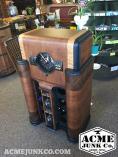 Antique Zenith radio cabinet we converted into an 8-bottle wine rack and working clock.