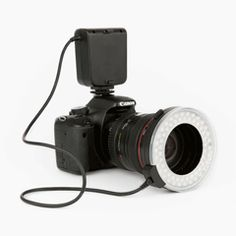 love this! for canon- $99. Surround your lens in a ring of LEDs for pro-lookin' light in photos or vids