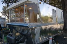 Unique curved windows in 1960 vintage Holiday House trailer dining area