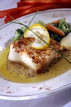 Fresh lemon enhances the flavor of cooked sea bass. definitely a #fitbook worthy meal - no matter which method you choose to prepare it.