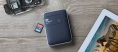 Western Digital has added an SD slot to their My Passport series of external hard drives! It's the perfect thing to back your photos up on location without pulling out your computer.