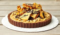 pb honeycomb pie; chocolate wafer crust, peanut butter vanilla bean rich custard, and topped with honeycomb, roasted peanuts, and chocolate