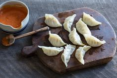 Nepali chicken dumplings (momo) For the tomato pickle (achar), pour mustard oil into a small saucepan and place over medium heat. When the oil is hot add garlic and ginger, fry for a few seconds or until starting to turn light golden. Add fenugreek seed, dried chillies, jimbu, and stir for few more seconds until fenugreek is starting to turn golden. Add chopped tomatoes and cook for 10 minutes, stirring occasionally until reduced and starting to thicken. Set aside to cool, then blend…