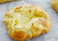 Ingredients: 1 (8 ounce) package cream cheese, diced 2 (10 ounce) cans crescent roll dough 1 tablespoon butter, softened 1 tablespoon milk 1/2 cup white sugar 1 teaspoon sour cream 1 teaspoon lemon juice 1 cup confectioners' sugar 3/4 teaspoon vanilla extract Preparation: 1. Preheat the oven to 350 degrees F (175 degrees C). 2. …