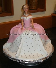 """This reminds me of my mom.  Every year on my birthday when I was a little girl, she'd make an angelfood cake with a barbie doll in it and decorate the """"skirt"""".  She's just the best."""