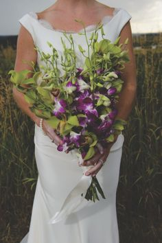 Purple orchids in this gorgeous #bouquet. Photography: Rachel Olsen - www.rachelolsenphotography.com, Floral Design: One Fine Day Productions -www.weddingsinsteamboat.com  Read More: http://www.stylemepretty.com/southwest-weddings/2014/04/28/rustic-ranch-wedding/
