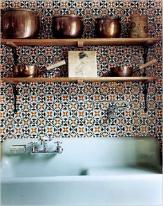 vintage sink, tiled wall and copper on display at Sean MacPherson's home in NY.